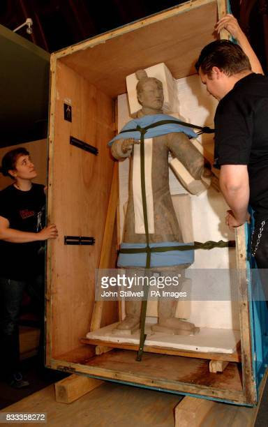 The first of the Terracotta army figures that will be exhibited at the British Museum is carefully unpacked from its cargo case in the reading room...