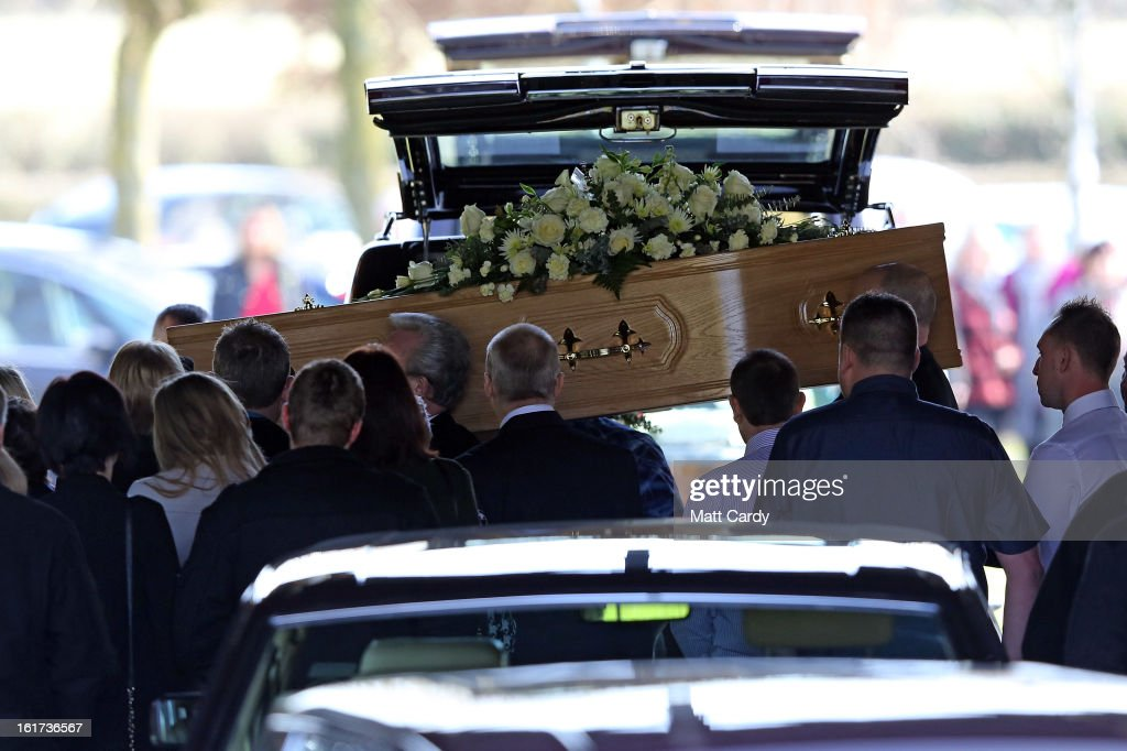 The first of the two coffins carrying the body of Ross Simons and his wife Clare is carried into Westerleigh Crematorium for their joint funeral on February 15, 2013 in Bristol, England. The couple were killed when their tandem bike collided with a car in Hanham. A 38-year-old man has been charged with two counts of causing death by dangerous driving after Ross Simons, 34, and Clare, 30, died at the scene of the crash in Bristol on January 27, 2013.