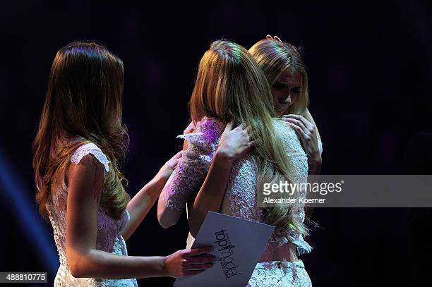 The first of three models Ivana Teklic cheers with model Stefanie Giesinger and Jolina Fust after being dismissed by the jury and presenter Heidi...