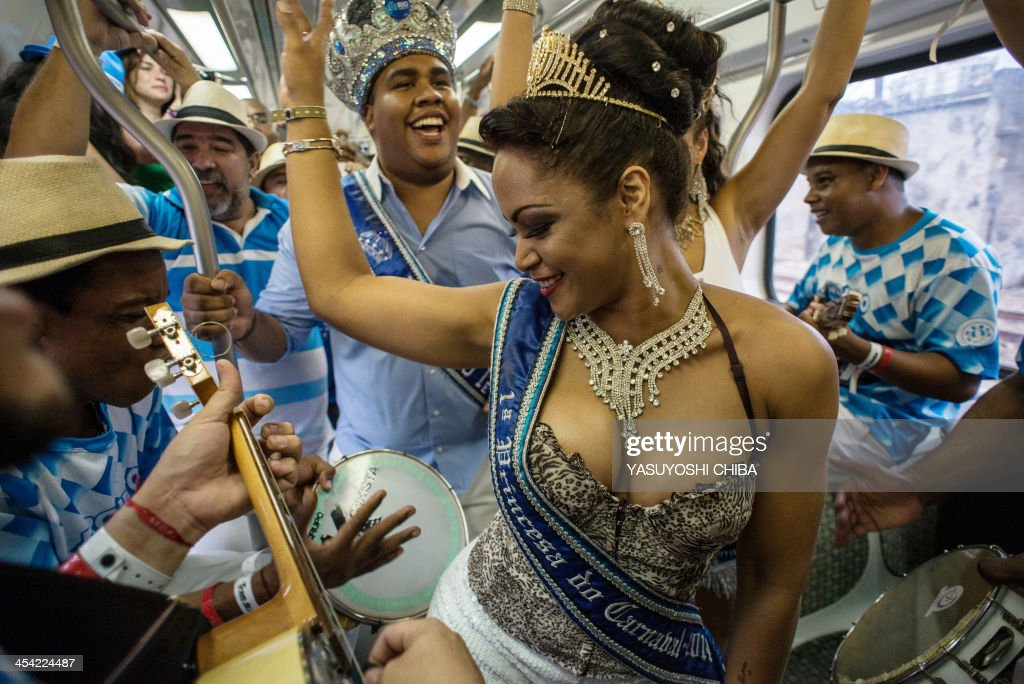 The first princess of Rio's Carnival 2014 performs with members of Vila Isabel Samba school perform on the special Samba train from Central station in Rio de Janeiro on December 7, 2013. Samba trains are offering direct 20-minute ride to the Oswaldo Cruz station where a 6-day-long event 'Trem do Samba' is taking place on the outskirts of Rio de Janeiro.