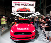 The first production 2015 Ford Mustang comes off the assembly line at the Ford Flat Rock Assembly Plant August 28 2014 in Flat Rock Michigan Ford's...