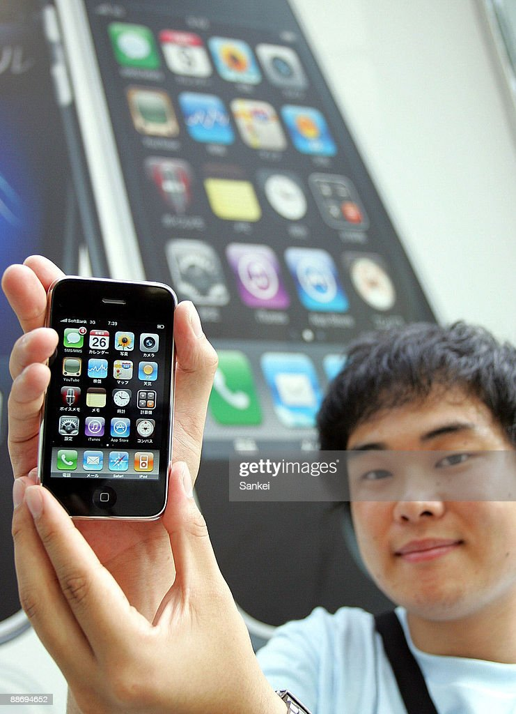 iphone japan. the first purchaser taisuke fujimoto shows iphone 3gs at softbank omotesando on june 26, 2009 iphone japan