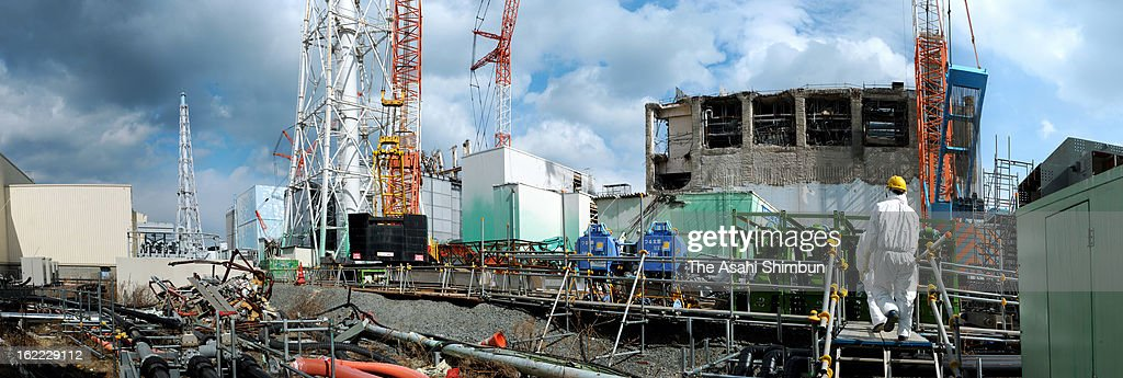 The first reactor (far left), second reactor (blue-coloured wall), third reactor (covered by light-gray panels) and fourth reactor (right) of Fukushima Daiichi Nuclear Power Plant are seen on February 20, 2013 in Okuma, Fukushima, Japan. The decommission work continues at the crippled plant in Fukushima, their operator Tokyo Electric Power Co and Japanese government plan to complete in around 2050.