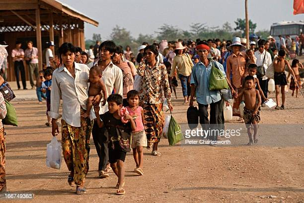 The first refugees to be repatriated back to Cambodia from refugee camps in Thailand arrive in Cambodia as part of the repatriation efforts of UNTAC