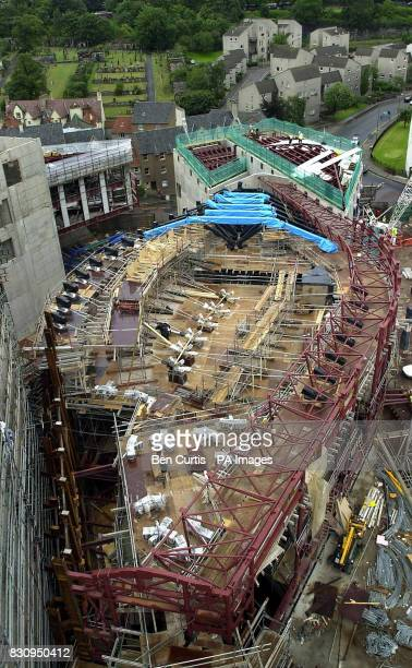The first section of steel reinforced oak beams that will span the debating chamber of the new Scottish Parliament building The specially laminated...