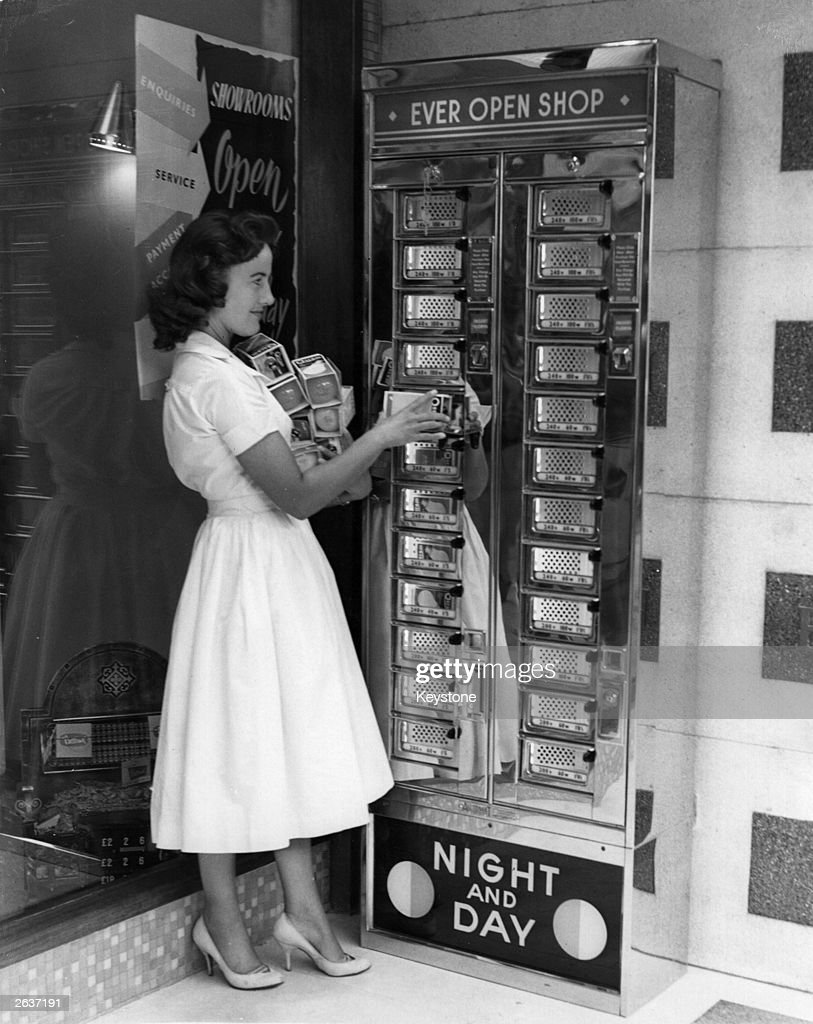 The first slot machine dispensing light bulbs, installed by the London Electricity Board at their showroom in Kirkdale, London.