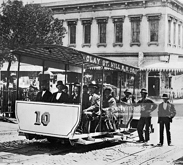 The first successful cable car line in San Francisco was the Clay Street Railroad started by Andrew Hallidie sitting at the far left in the front...