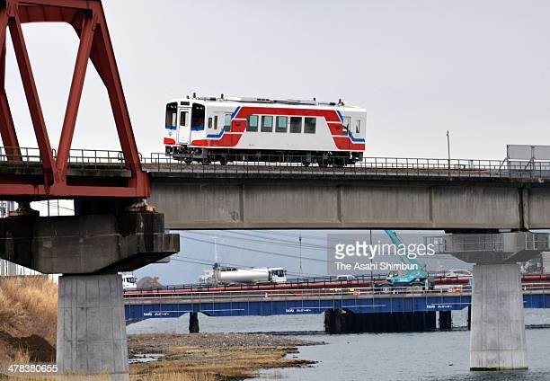The first test train of Sanriku Railway runs cross the Katsushigawa River for the first time since the Great East Japan earthquake and subsequent...