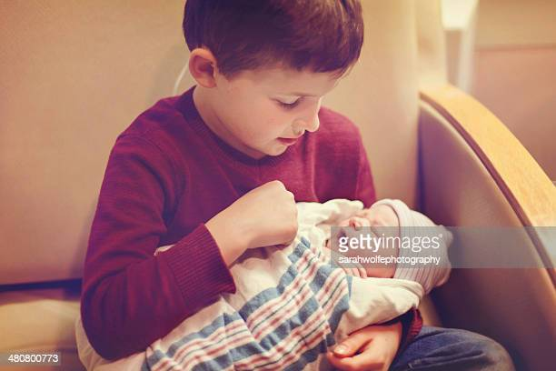 the first time he held his brother