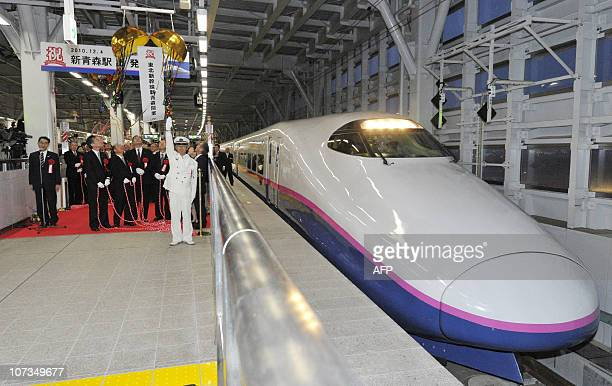 The first Tokyobound Tohoku Shinkansen bullet train leaves ShinAomori Station following a ceremony in Aomori northern Japan on December 4 2010 Japan...
