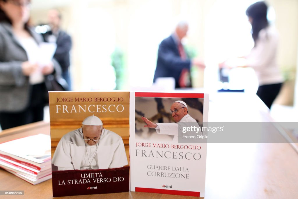 The first two books by newly elected <a gi-track='captionPersonalityLinkClicked' href=/galleries/search?phrase=Pope+Francis&family=editorial&specificpeople=2499404 ng-click='$event.stopPropagation()'>Pope Francis</a> are displayed during the presentation at the Curci Hall of the offices of the Jesuit periodical 'La Civilta Cattolica' on March 26, 2013 in Rome, Italy. 'Guarire dalla corruzione' (Recovering from Corruption) and 'Umilta, la strada verso Dio (Humility: The Road towards God) are the titles of the first two books written by the <a gi-track='captionPersonalityLinkClicked' href=/galleries/search?phrase=Pope+Francis&family=editorial&specificpeople=2499404 ng-click='$event.stopPropagation()'>Pope Francis</a> and published in Italian. Both texts were written in Spanish in 2006 when he was Archbishop of Buenos Aires, drawing upon the spirituality expressed by St. Ignatius of Loyola in his 'Spiritual Exercises' to describe the profound mechanism of corruption in society, including the Church, and to note solutions, among which is the need for an ecclesial life characterized by fraternal charity.