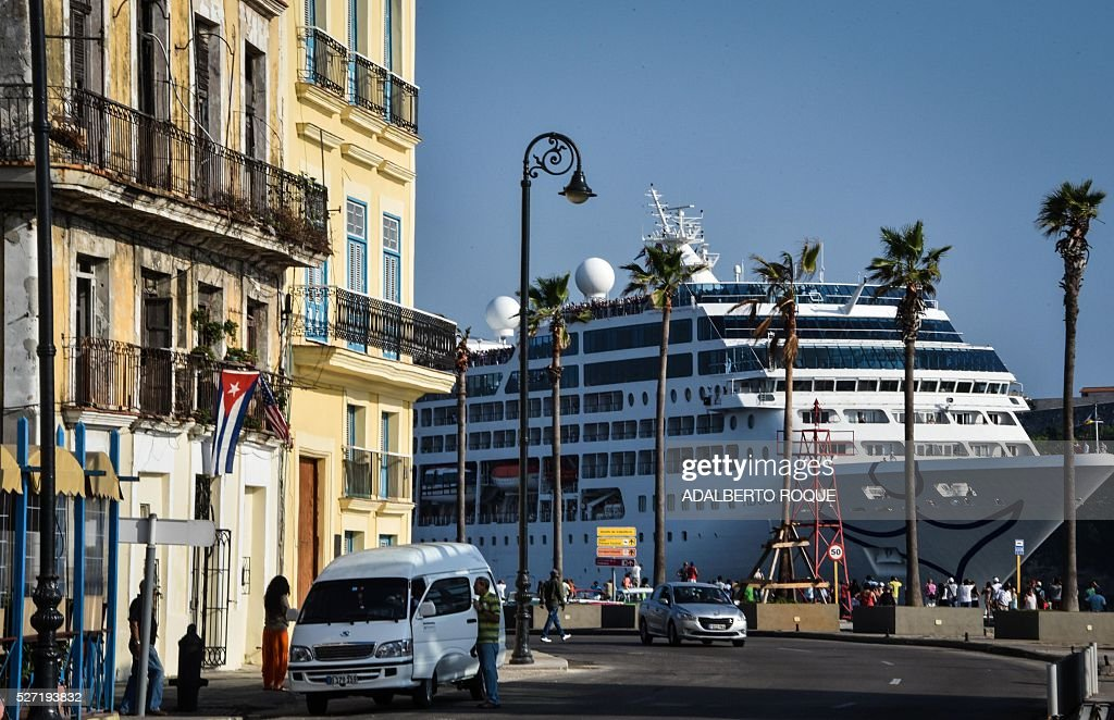 The first US-to-Cuba cruise ship to arrive in the island nation in decades glides into the port of Havana, on May 2, 2016. The first US cruise ship bound for Cuba in half a century, the Adonia -- a vessel from the Carnival cruise's Fathom line -- set sail from Florida on Sunday, marking a new milestone in the rapprochement between Washington and Havana. The ship -- with 700 passengers aboard -- departed from Miami, the heart of the Cuban diaspora in the United States. / AFP / ADALBERTO