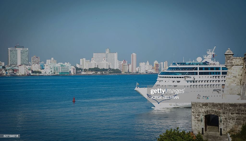The first US-to-Cuba cruise ship to arrive in the island nation in decades glides into the port of Havana, on May 2, 2016. The first US cruise ship bound for Cuba in half a century, the Adonia -- a vessel from the Carnival cruise's Fathom line -- set sail from Florida on Sunday, marking a new milestone in the rapprochement between Washington and Havana. The ship -- with 700 passengers aboard -- departed from Miami, the heart of the Cuban diaspora in the United States. / AFP / JORGE