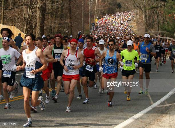 The first wave of runners head out after the start of the 2008 Boston Marathon on April 212008 in Hopkinton Massachusetts