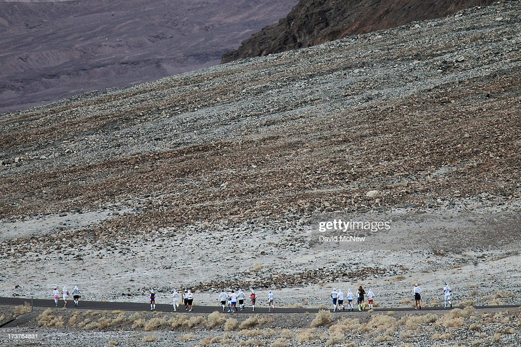 The first wave of runners leaves Badwater Basin during the AdventurCORPS Badwater 135 ultra-marathon race on July 15, 2013 in Death Valley National Park, California. Billed as the toughest footrace in the world, the 36th annual Badwater 135 starts at Badwater Basin in Death Valley, 280 feet below sea level, where athletes begin a 135-mile non-stop run over three mountain ranges in extreme mid-summer desert heat to finish at 8,350-foot near Mount Whitney for a total cumulative vertical ascent of 13,000 feet. July 10 marked the 100-year anniversary of the all-time hottest world record temperature of 134 degrees, set in Death Valley where the average high in July is 116. A total of 96 competitors from 22 nations are attempting the run which equals about five back-to-back marathons. Previous winners have completed all 135 miles in slightly less than 24 hours.