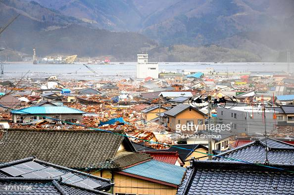 The first wave of tsunami triggered by the magnitude 90 strong earthquake approaches to Ofunato city on March 11 2011 in Ofunato Iwate Japan The...