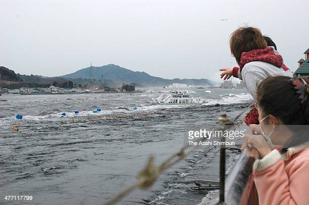 The first wave of tsunami triggered by the magnitude 90 strong earthquake approaches to Kesennuma city on March 11 2011 in Kesennuma Miyagi Japan The...