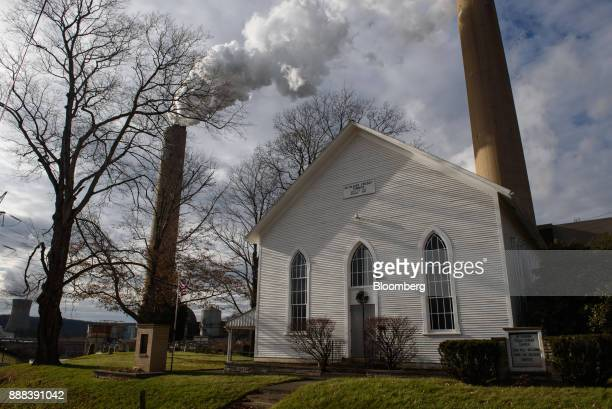 The FirstEnergy Corp Bruce Mansfield coalfired power plant stands behind the Bethlehem Presbyterian Church in Shippingport Pennsylvania US on...