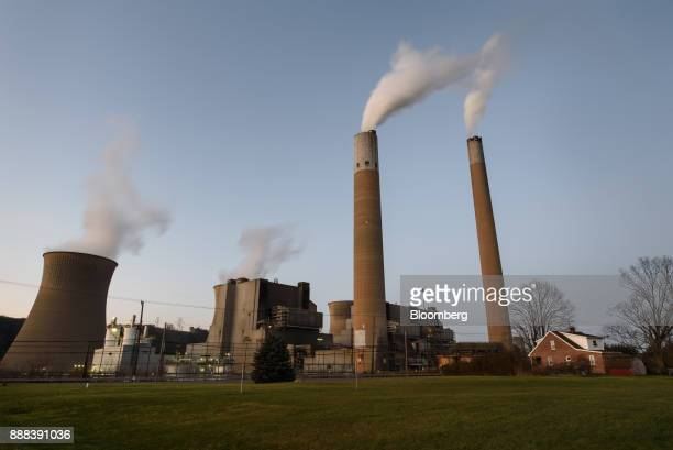 The FirstEnergy Corp Bruce Mansfield coalfired power plant stands next to a house in Shippingport Pennsylvania US on Sunday Dec 3 2017 Across America...