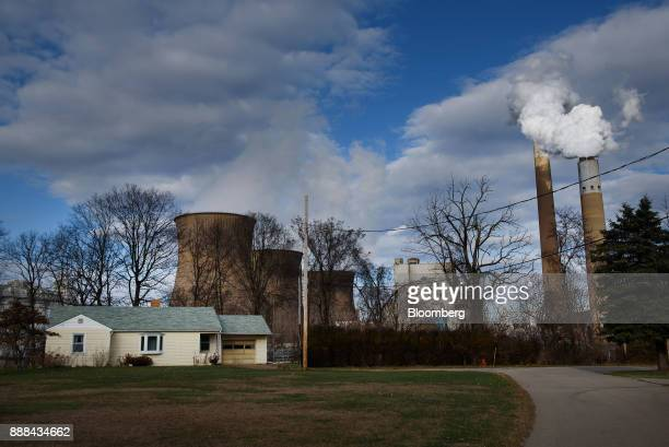The FirstEnergy Corp Bruce Mansfield coalfired power plant stands next to a house in Shippingport Pennsylvania US on Wednesday Dec 6 2017 Across...