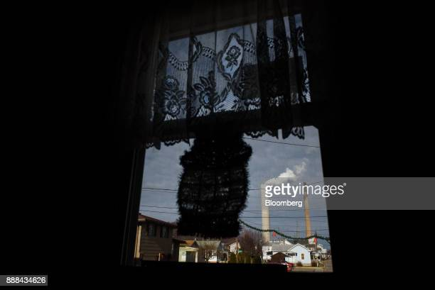 The FirstEnergy Corp WH Sammis Plant coalfired power plant is seen through the window of the Post Office in Stratton Ohio US on Wednesday Dec 6 2017...