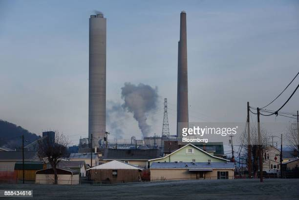 The FirstEnergy Corp WH Sammis Plant coalfired power plant stands past houses in Stratton Ohio US on Monday Dec 4 2017 Across America few places are...