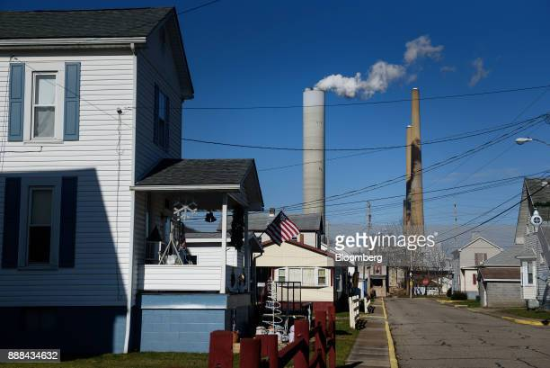 The FirstEnergy Corp WH Sammis Plant coalfired power plant stands past houses in Stratton Ohio US on Wednesday Dec 6 2017 Across America few places...