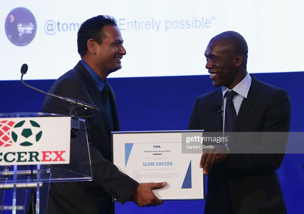 The first-ever FIFA Diversity Award is presented to Abhijeet Barse from Slum Soccer by Clarence Seedorf, former Netherlands International during day 1 of the Soccerex Global Convention 2016 at Manchester Central Convention Complex on September 26, 2016 in Manchester, England.