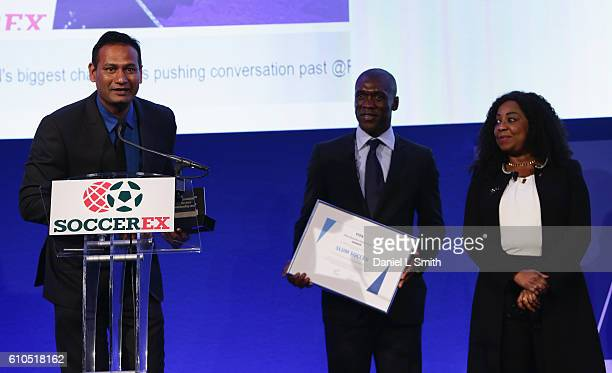 The firstever FIFA Diversity Award is presented to Abhijeet Barse from Slum Soccer by Fatma Samba Diouf Samoura FIFA Secretary General and Clarence...