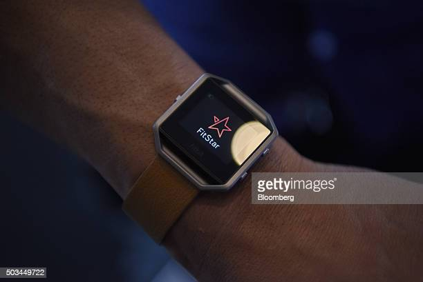 The FitBit Inc Blaze fitness tracker is displayed for a photograph during an event at the 2016 Consumer Electronics Show in Las Vegas Nevada US on...