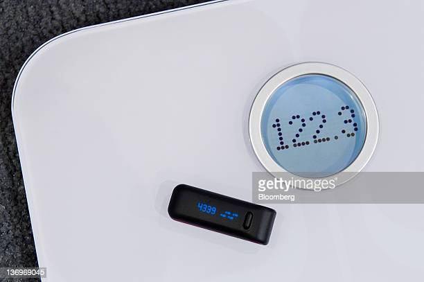 The Fitbit micro wifi scale and Fitbit ultra made by Fitbit Inc sits on display at the International Consumer Electronics Show in Las Vegas Nevada US...