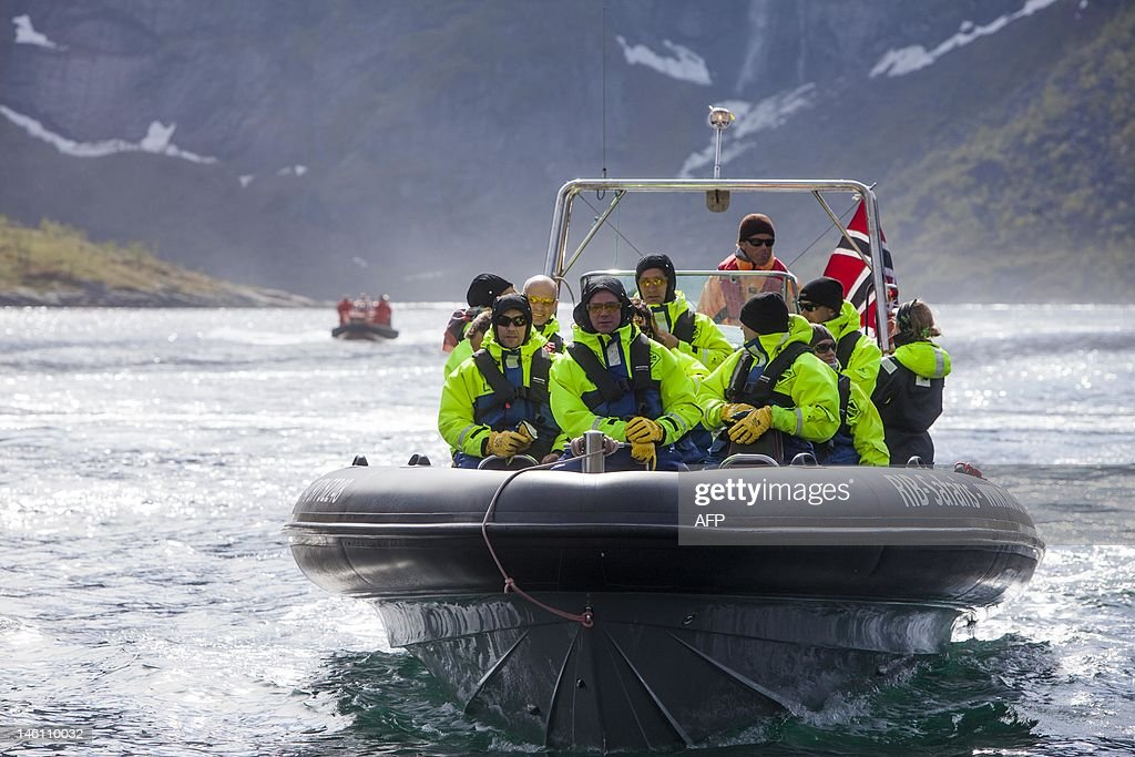 The five Nordic prime ministers of Iceland, Denmark, Sweden, Finland and Norway are taken on a boat trip with their spouses in the Lofoten archipelago, in northern Norway, on June 10, 2012. The five prime ministers meet to discuss regional, European and world questions during theri meeting. AFP PHOTO / SCANPIX NORWAY / Jan-Morten Bjoernbakk