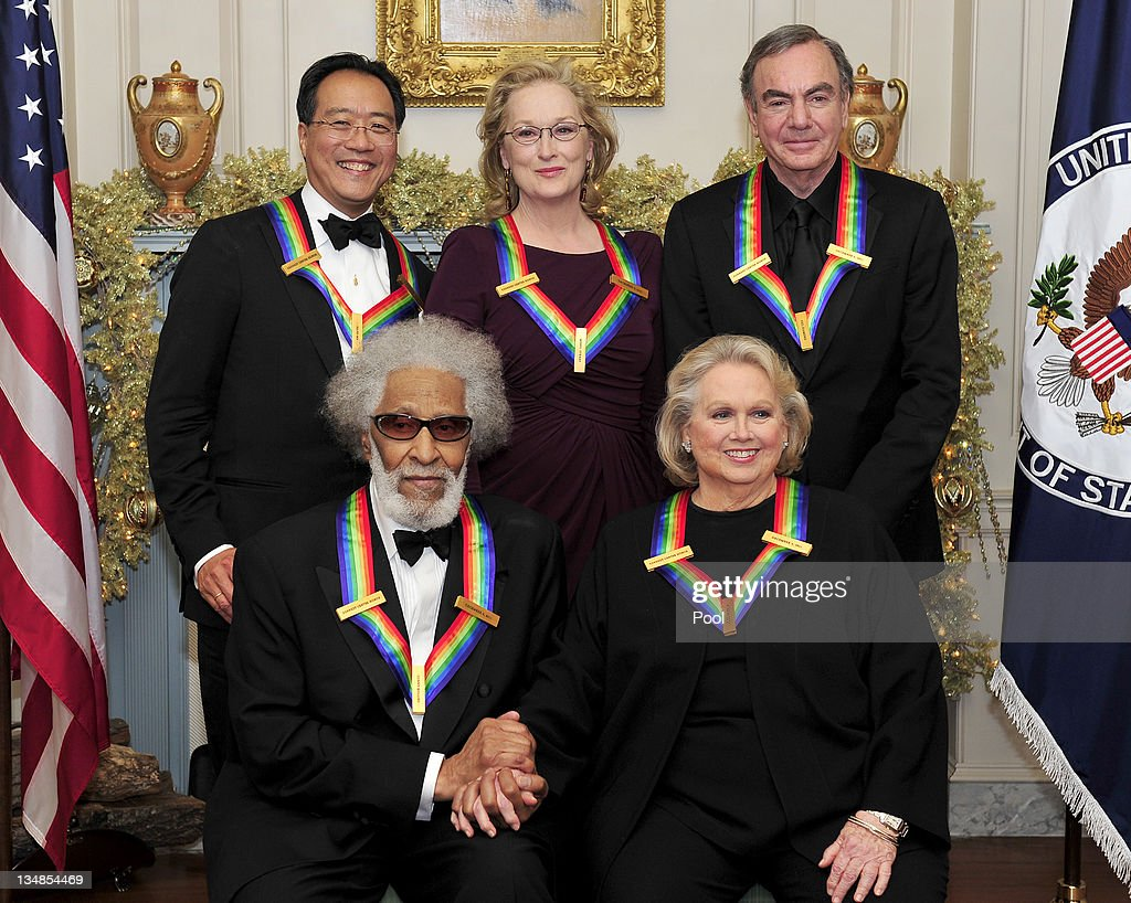 The five recipients of the 2011 Kennedy Center Honors, Back row, from left to right: musician Yo-Yo Ma; actress Meryl Streep; and singer Neil Diamond. Front row, from left to right: musician Sonny Rollins; and actress Barbara Cook pose for a photo following a dinner hosted by United States Secretary of State Hillary Rodham Clinton at the U.S. Department of State December 3, 2011 in Washington, DC. President Barack Obama will host the five recipients of the 34th Kennedy Center Honors at a White House reception Sunday before attending the evening gala at the John F. Kennedy Center for the Performing Arts. The 2011 honorees are actress Meryl Streep, singer Neil Diamond, actress Barbara Cook, musician Yo-Yo Ma, and musician Sonny Rollins..