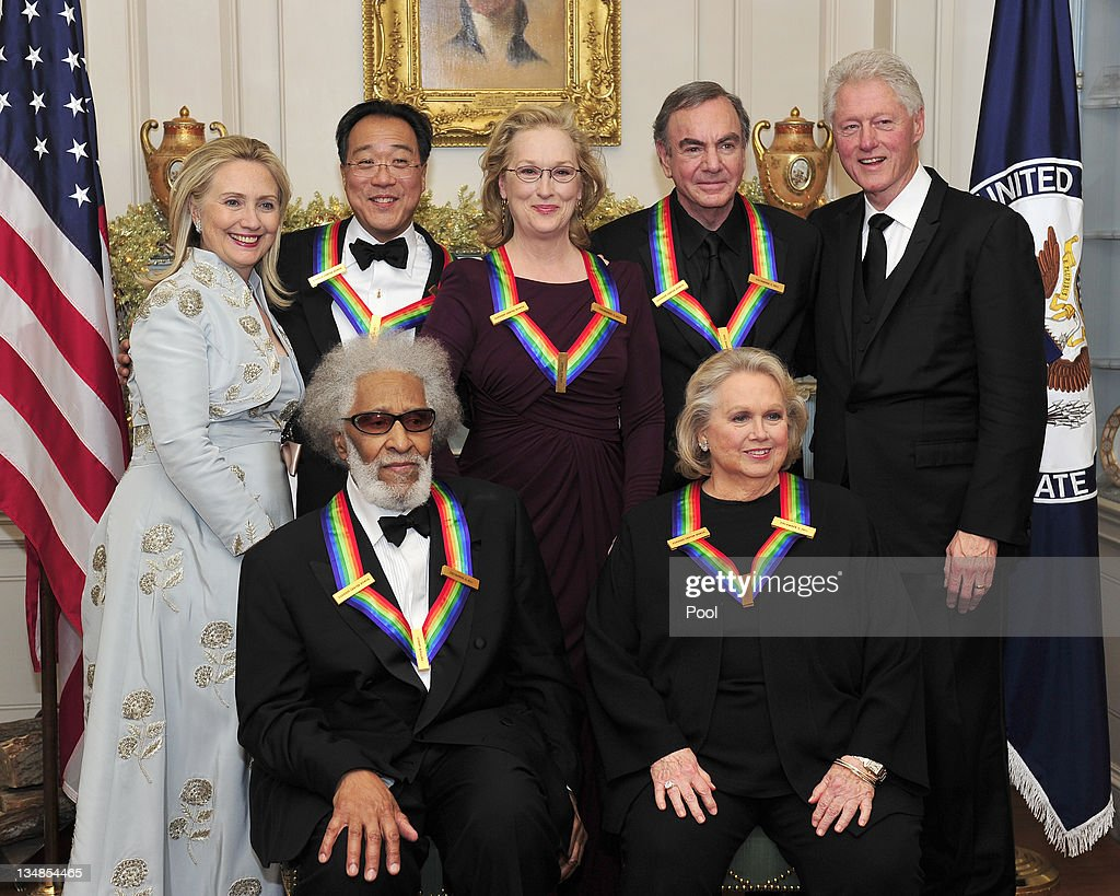 The five recipients of the 2011 Kennedy Center Honors pose for a photo with United States Secretary of State Hillary Rodham Clinton and former U.S. President <a gi-track='captionPersonalityLinkClicked' href=/galleries/search?phrase=Bill+Clinton&family=editorial&specificpeople=67203 ng-click='$event.stopPropagation()'>Bill Clinton</a> following a dinner hosted by Secretary Clinton at the U.S. Department of State December 3, 2011 in Washington, DC. President Barack Obama will host the five recipients of the 34th Kennedy Center Honors at a White House reception Sunday before attending the evening gala at the John F. Kennedy Center for the Performing Arts. The 2011 honorees are actress <a gi-track='captionPersonalityLinkClicked' href=/galleries/search?phrase=Meryl+Streep&family=editorial&specificpeople=171097 ng-click='$event.stopPropagation()'>Meryl Streep</a>, singer <a gi-track='captionPersonalityLinkClicked' href=/galleries/search?phrase=Neil+Diamond&family=editorial&specificpeople=210635 ng-click='$event.stopPropagation()'>Neil Diamond</a>, actress <a gi-track='captionPersonalityLinkClicked' href=/galleries/search?phrase=Barbara+Cook&family=editorial&specificpeople=585933 ng-click='$event.stopPropagation()'>Barbara Cook</a>, musician <a gi-track='captionPersonalityLinkClicked' href=/galleries/search?phrase=Yo-Yo+Ma&family=editorial&specificpeople=235395 ng-click='$event.stopPropagation()'>Yo-Yo Ma</a>, and musician <a gi-track='captionPersonalityLinkClicked' href=/galleries/search?phrase=Sonny+Rollins&family=editorial&specificpeople=1661733 ng-click='$event.stopPropagation()'>Sonny Rollins</a>..