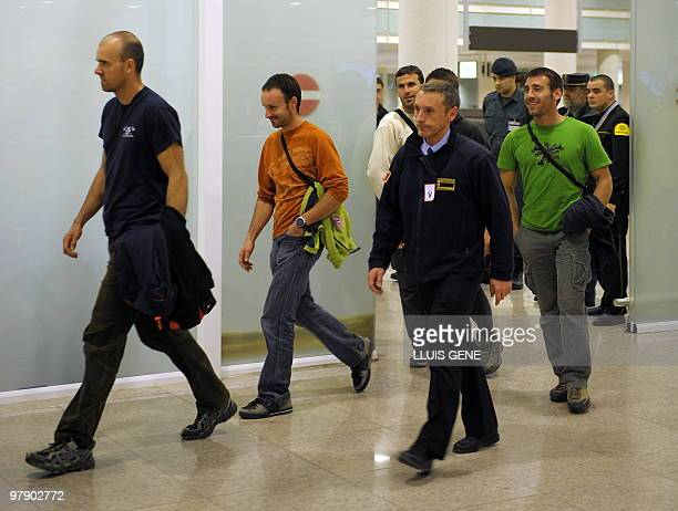 The five Spanish firemen who were mistaken for members of the Basque separatist group ETA on a surveillance video arrive at Barcelona's airport on...