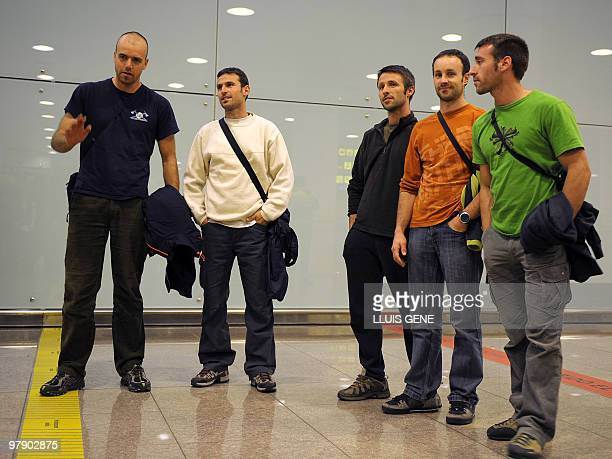 The five Spanish firemen who were mistaken for members of the Basque separatist group ETA on a surveillance video pose as they arrive at Barcelona's...