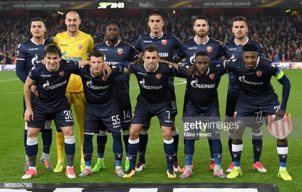 The FK Crvena Zvezda team line up prior to the UEFA Europa League group H match between Arsenal FC and Crvena Zvezda at Emirates Stadium on November...