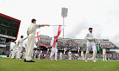 The Flag bearers welcome the England players onto the pitch before day three of the 2nd Investec Test match between England and Pakistan at Old...