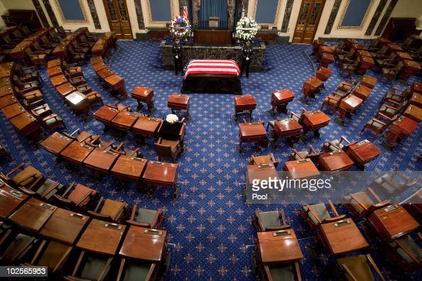 The flag draped casket of Sen Robert Byrd is guarded as he lies in repose in the Senate Chamber of the US Capitol on July 1 2010 in Washington DC...