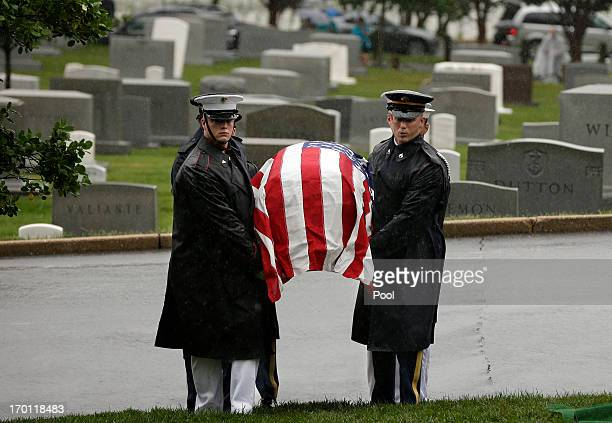The flag draped casket of the late New Jersey Sen Frank R Lautenberg is carried by members of the Joint Military Casket Team during burial services...