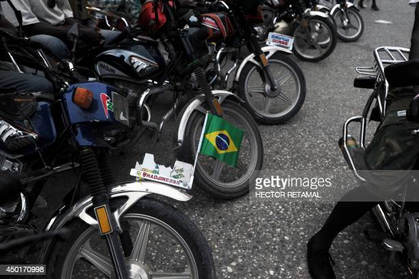 The flag of Brazil is seen on a motorcycle on June 5 2014 in Port au Prince In the days before the 2014 World Cup there are many cars motorcycles...