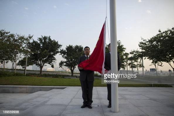 The flag of China is prepared for raising during a daily ceremony at Golden Bauhinia Square in Hong Kong China on Wednesday Jan 16 2013 Hong Kong...