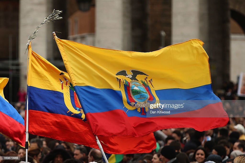 The flag of Ecuador is held as people gather in St Peter's Square ahead of the arrival of Pope Francis who will give his first Angelus Blessing to the faithful from the window of his private residence on March 17, 2013 in Vatican City, Vatican. The Vatican is preparing for the inauguration of Pope Francis on March 19, 2013 in St Peter's Square.