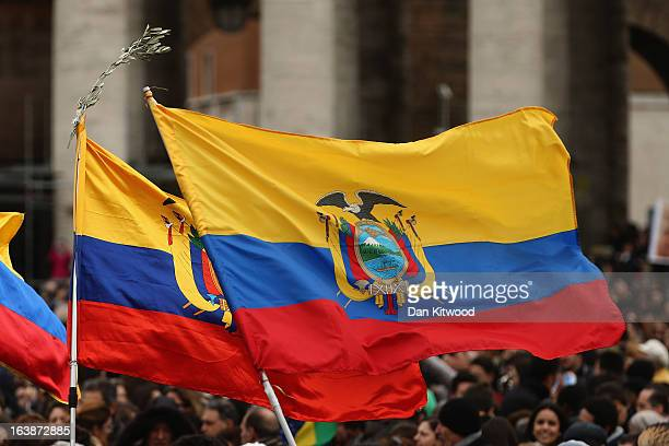 The flag of Ecuador is held as people gather in St Peter's Square ahead of the arrival of Pope Francis who will give his first Angelus Blessing to...