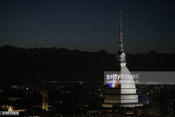 The flag of France illuminates the Mole Antonelliana in Turin on July 15 after the deadly attacks in Nice A man drove a truck into a crowd watching...