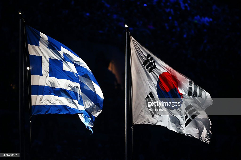 The flag of Greece flies next to the flag of South Korea during the 2014 Sochi Winter Olympics Closing Ceremony at Fisht Olympic Stadium on February 23, 2014 in Sochi, Russia.