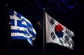 The flag of Greece flies next to the flag of South Korea during the 2014 Sochi Winter Olympics Closing Ceremony at Fisht Olympic Stadium on February...