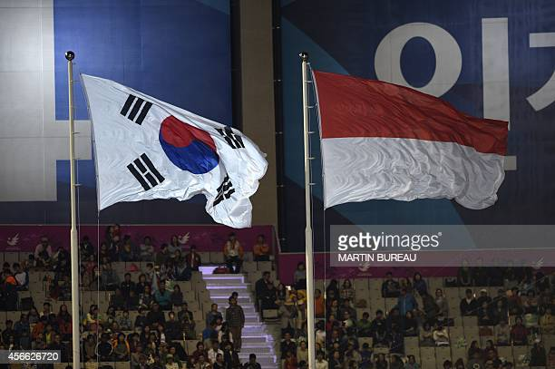 The flag of Indonesia the hosts of the 18th Asian Games in 2018 flies next to the flag of South Korea during the closing ceremony of the 2014 Asian...