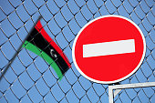 the flag of Libya behind the fence