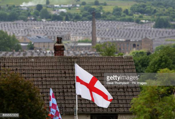 The flag of St George flies over Burnley Lancashire where the BNP today won its first county council seat Labour faced a routing in the town's local...